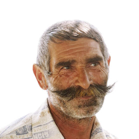 Portrait of elderly man with great moustaches against white background Stock Photo - 7757280