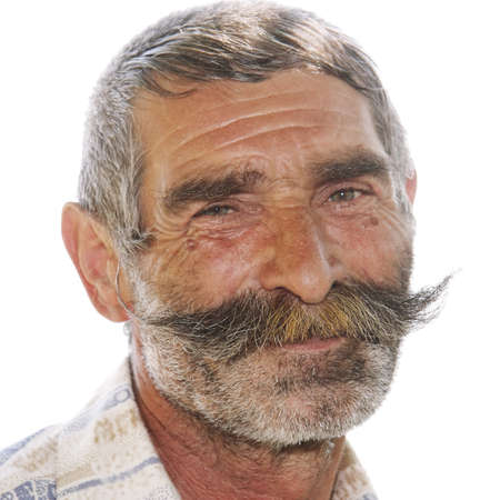 Portrait of positive elderly man with great moustaches photo