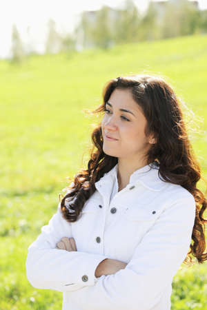 looking sideways: Young confident brunette in white casual clothes looking sideways