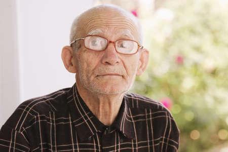 Senior man in eyeglasses looking to camera outdoor portrait Stock Photo - 7868251