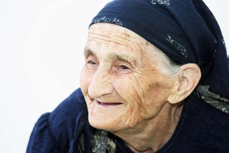 Closeup portrait of smiling elderly woman looking sideways Stock Photo - 8022398
