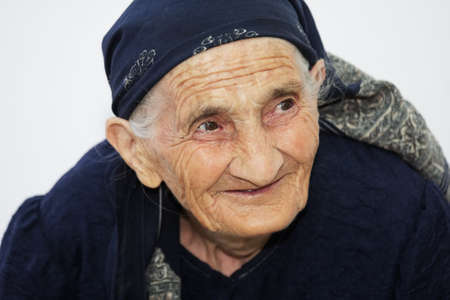 Closeup portrait of cute smiling elderly woman looking sideways Stock Photo - 8022373