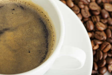 coffee crop: Espresso in white cup and coffee crop selective focus