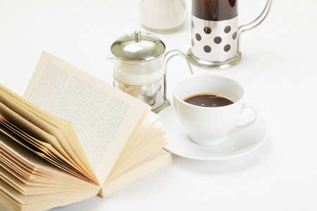 Coffee with various food and book on white tablecloth Stock Photo