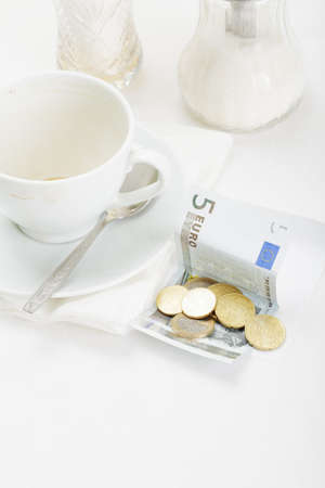 Banknote and several coins laying down on receipt for coffee payment Stock Photo - 8099712
