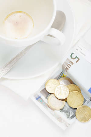 Banknote and coins on receipt for coffee payment above view Stock Photo - 8099707