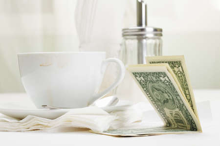 Dollar banknotes laying down on receipt for coffee payment Stock Photo - 8099709