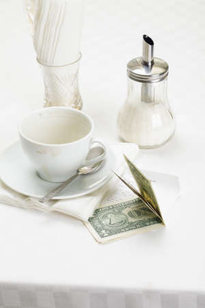 Several dollar banknotes on table for coffee payment above view Stock Photo - 8099708