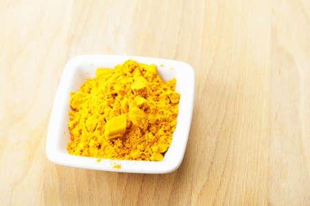 Saffron spice in white ceramic dish on wooden board Stock Photo - 8176607
