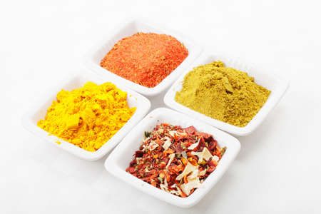 Various spices in white dishes on tablecloth closeup photo Stock Photo - 8176616