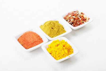 Spicy formation consisting of saffron in front and various mixtures Stock Photo - 8176615
