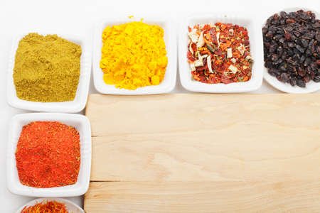 Vaus spices at empty wooden board above view Stock Photo - 8176621