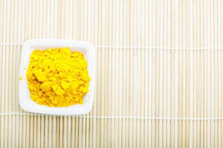 Saffron spice in white ceramic dish on straw mat above view Stock Photo - 8176638