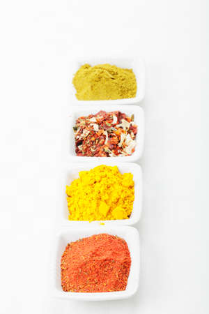 Various grounded spices in a row  on tablecloth above view Stock Photo - 8176635