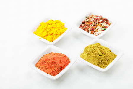 Four different spices in white dishes over tablecloth Stock Photo - 8176640