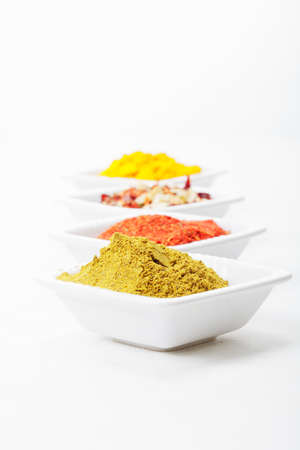 Row of warious grounded spices against light background Stock Photo - 8176622