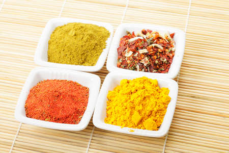 Various spices in white dishes on straw mat closeup photo Stock Photo - 8176649