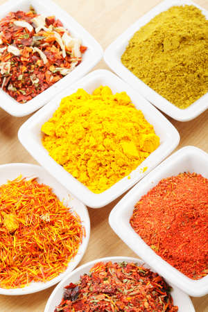 Lot of spices in white dishes on straw mat closeup photo Stock Photo - 8176655