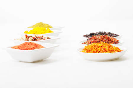 Two rows of spices grouped by dish shape laying opposite Stock Photo - 8176626