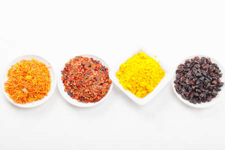 Different grounded spices in a row  one standing out in dish shape Stock Photo - 8176643