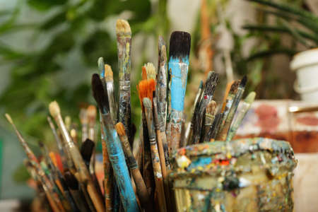 Various used paintbrushes soiled with paints closeup photo Stock Photo - 9224103