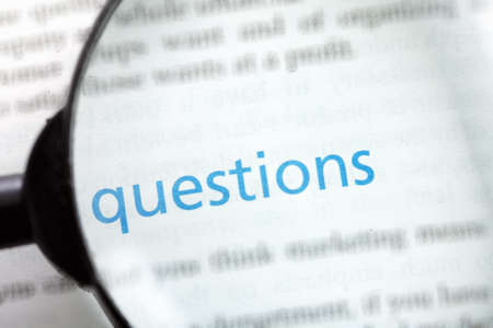 Question word printed on page seen through magnifier Stock Photo - 9248981