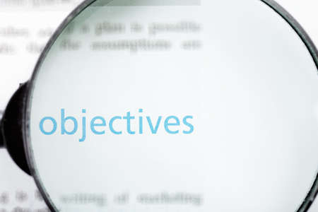 Objectives word printed on page seen through magnifier Stock Photo - 9248965