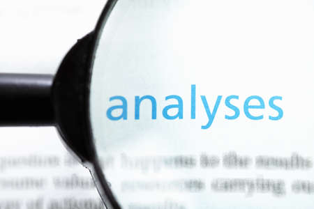 analyses: Analyses word printed on page seen through magnifier