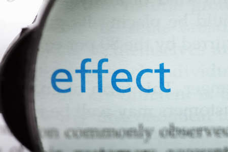 Effect word printed on page seen through magnifier Stock Photo - 9248993