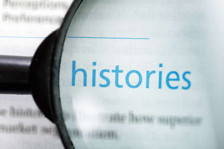 Histories word printed on page seen through magnifier Stock Photo - 9248997