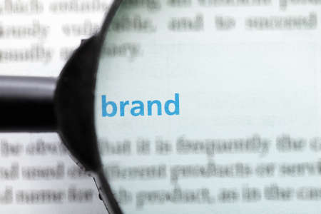 Brand word printed on page seen through magnifier Stock Photo - 9248982
