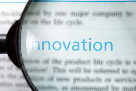 Innovation word printed on page seen through magnifier Stock Photo - 9248983