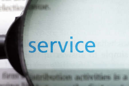 Service word printed on page seen through magnifier Stock Photo - 9248986