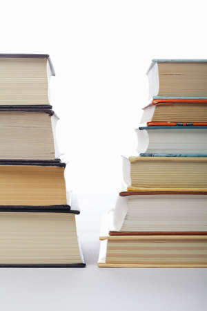 Serious books against fiction stacked in staircase forms Stock Photo - 9224040
