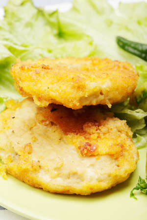 Breaded chicken cutlets and salad closeup photo photo