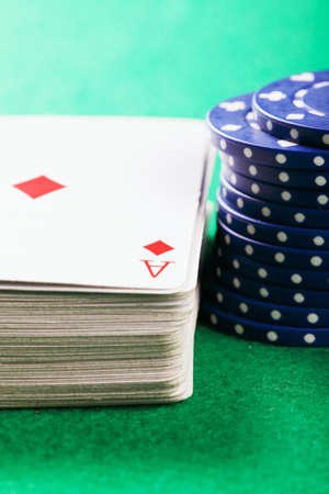 Blue stacked poker chips and cards selective focus photo
