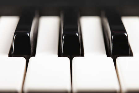 Piano keys closeup photo front view