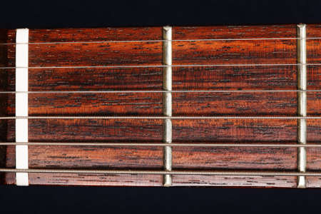 Guitar neck closeup photo against dark background Stock Photo - 9224897