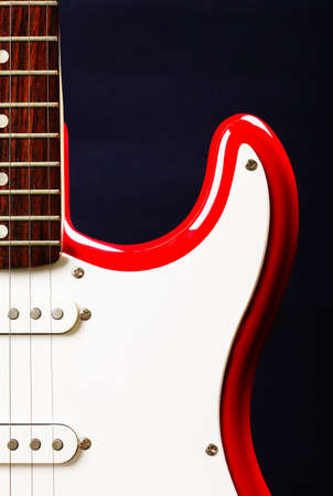 Red and white guitar against dark background Stock Photo - 9223613