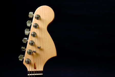 Guitar headstock against dark background Stock Photo - 9223531