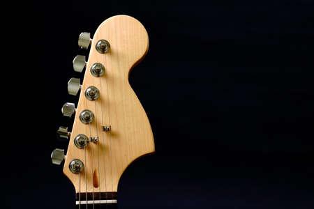 Guitar headstock against dark background Stock Photo - 9223531