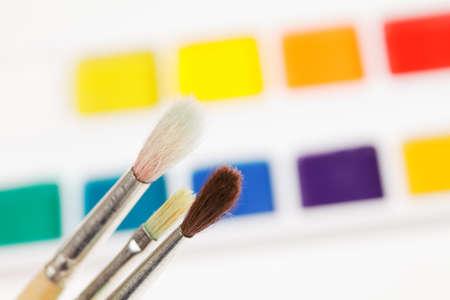 Paintbrushes against various aquarelle paints Stock Photo - 9284824