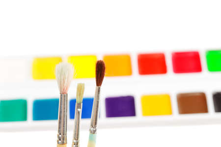 Three paintbrushes against various paints copyspace above Stock Photo - 9284833