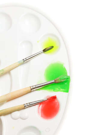 Palette and three brushes over white Stock Photo - 9284836
