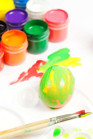 Painted egg and brushes photo