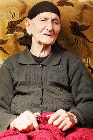 looking sideways: Senior woman with knit looking sideways