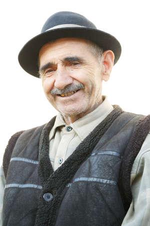 hoariness: Portrait of smiling elderly man against white background