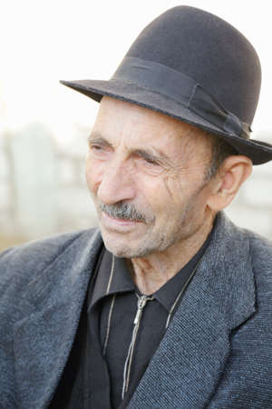 Portrait of elderly man in hat looking sideways Stock Photo - 9393936