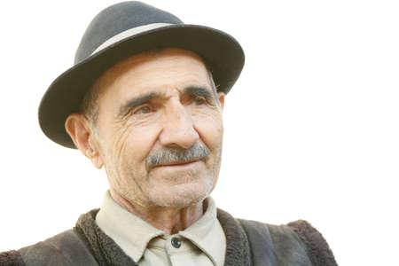 grayness: Portrait of elderly man looking sideways against white Stock Photo