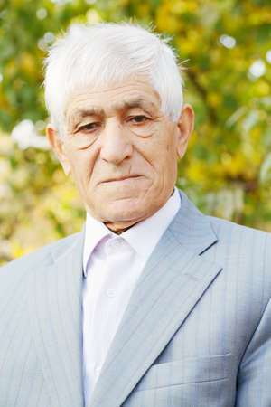 grayness: Portrait of serious senior man in formal wear Stock Photo